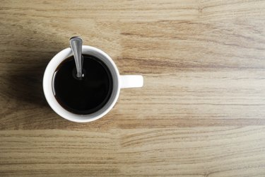 Cup of black coffee on wood background