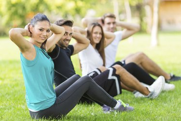 Group of people exercising in park