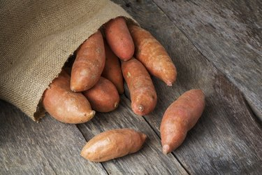 Sweet Potatoes Spilling From Burlap Bag