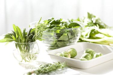 Assortment of green vegetables on a kitchen counter