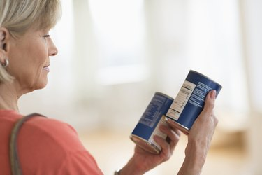 Woman Comparing Products In Shop