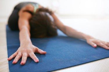 Fitness woman doing balasana yoga