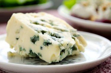 gorgonzola cheese on white plate