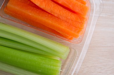 Carrot sticks and celery sticks in plastic tray