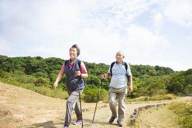 asian senior couple hiking