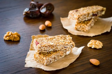 Granola bars or energy bars on brown background