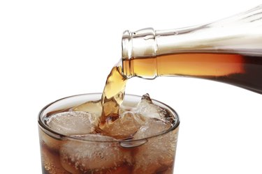 Cola pouring into a glass