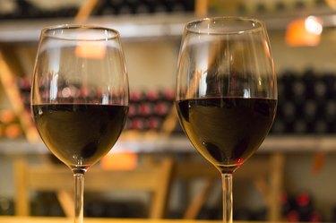 Wine glasses full of red wine