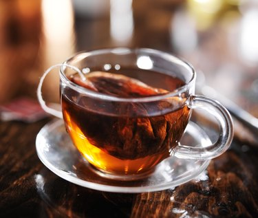 hot cup of tea steeping in glass