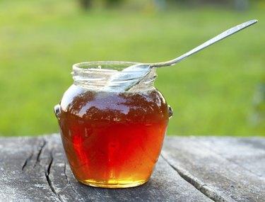honey on wooden garden table