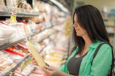 Woman is buying frozen meats