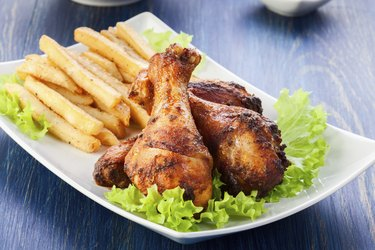 Chicken drumsticks with french fries