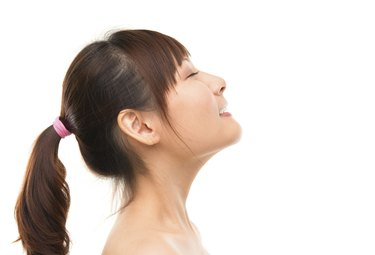 Asian skincare woman side view deep breath refreshing