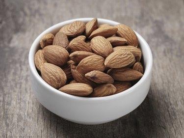 white bowl full of almonds