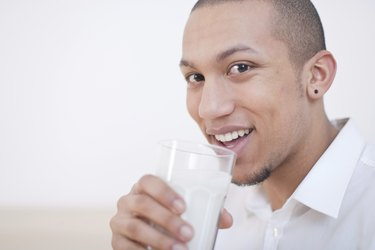 Young African-American Man Drinking Milk