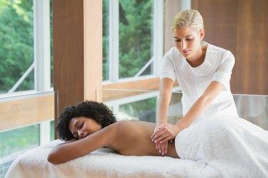 Gorgeous woman enjoying a back massage