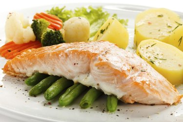 roasted salmon, boiled potatoes and vegetables