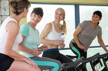 Group of senior women having a chat at the gym