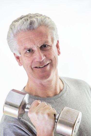 Senior man with gym weights