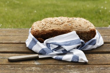 Wholemeal wheat spelt bread on wooden table