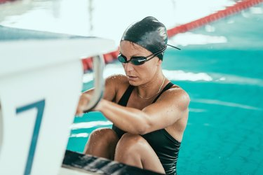 Backstroke swimmer at the race starting block