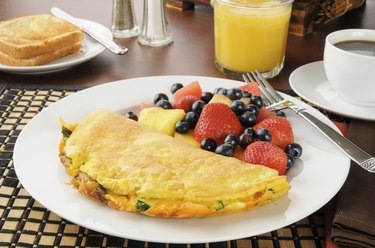 Breakfast omelet wiht fruit and berries