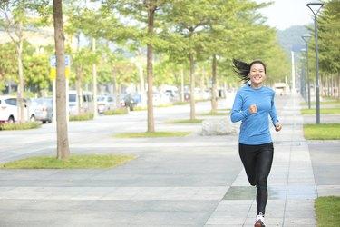 sports asian woman jogging