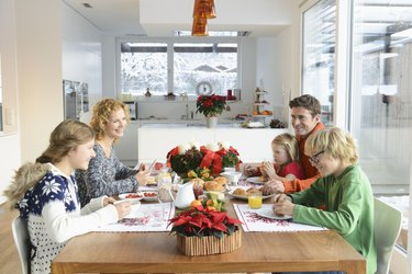 Couple with three children sitting at breakfast table