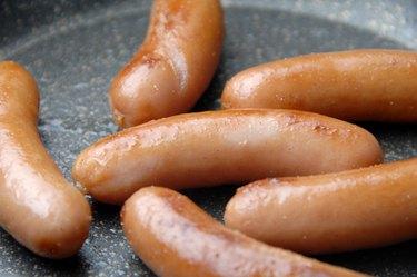 Sausage on frying pan