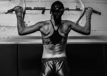 Female MMA Fighter doing pull-ups