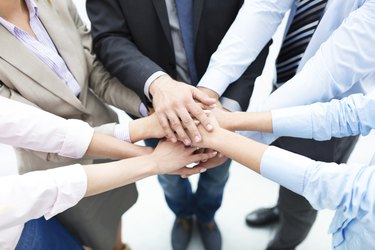 Business people joining hands in circle
