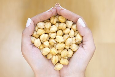 Chickpeas in woman hands