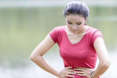 Young beautiful woman is having stomach ache