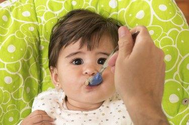 Feeding a cute Lovely Baby Girl