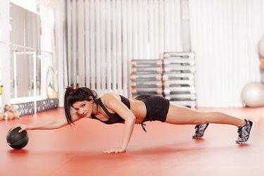 pilates with a medicine ball