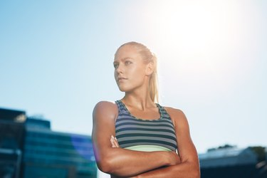 Muscular female athlete in outdoors stadium