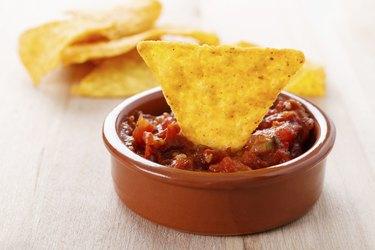 tortilla chip with hot salsa dip