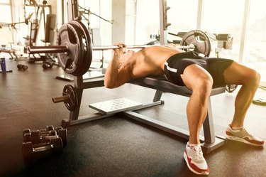 Muscular bodybuilder bench press workout