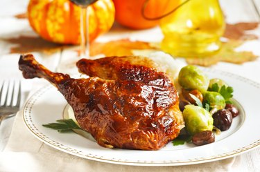 Roasted turkey leg with mash potato, chestnuts and brussels sprouts.