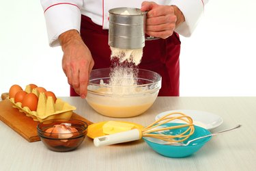Sifting flour into batter