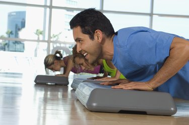 People Doing Pushups in Exercise Class