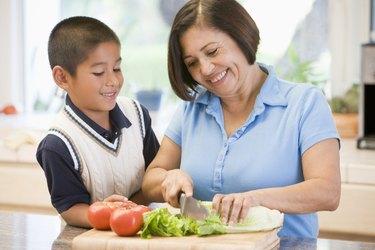 Grandmother And Grandson Preparing meal,mealtime Together