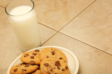 Cookies and glass of milk on work surface