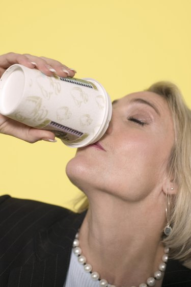 Woman drinking from beverage cup