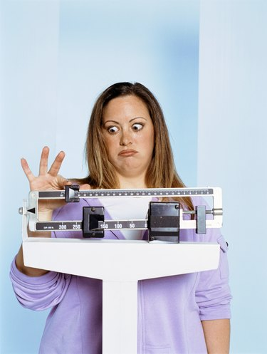 Unhappy woman on scale