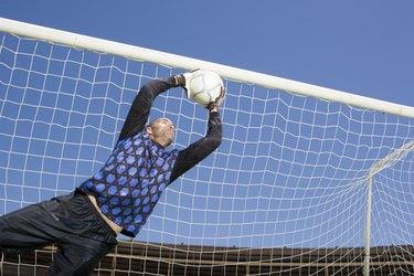 Goalie catching soccer ball