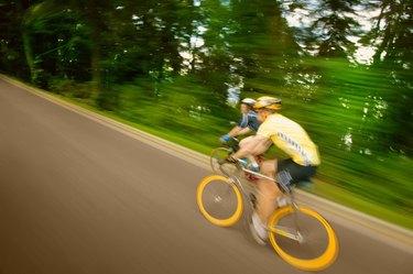 Two people racing on bikes