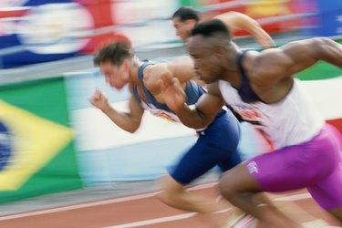 Three men running at a race
