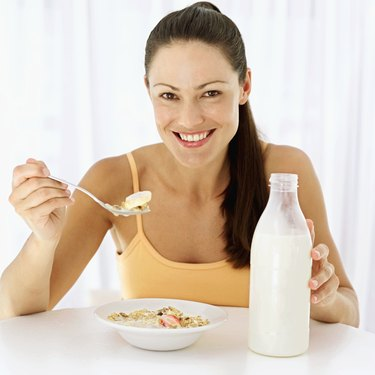 Portrait of a woman eating breakfast cereal with a spoon