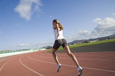 Woman running on track